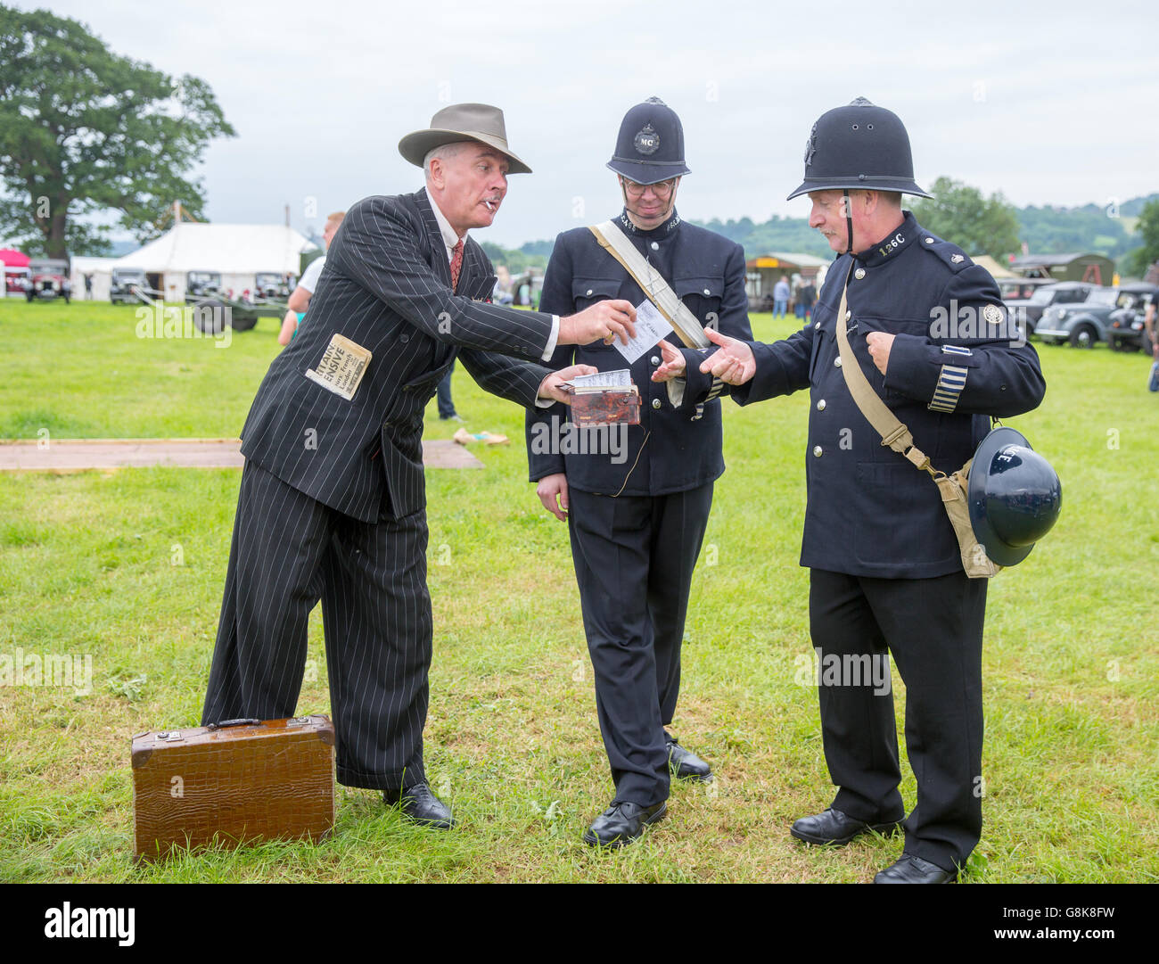 A spiv and police officers at the 'Dig For VIctory Show' at the NOrth Somerset Show Ground - Stock Image