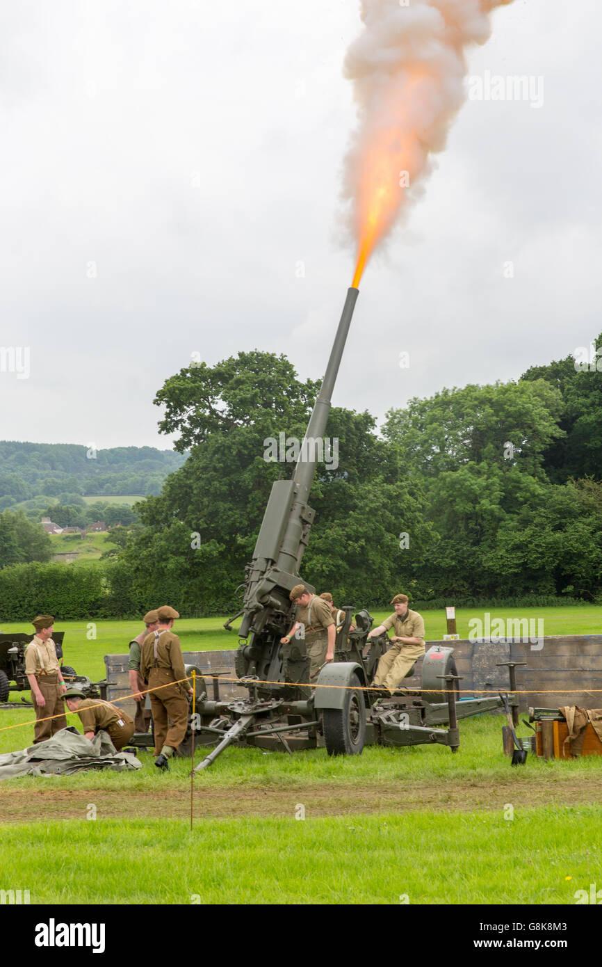 World War 2 reenactment firing an historic anti-aircraft artillery piece - Stock Image