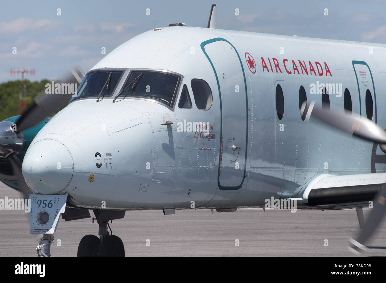 Air Canada Express Beechcraft 1900D aircraft, operated by Georgian air taxis to the runway before take-off from - Stock Image