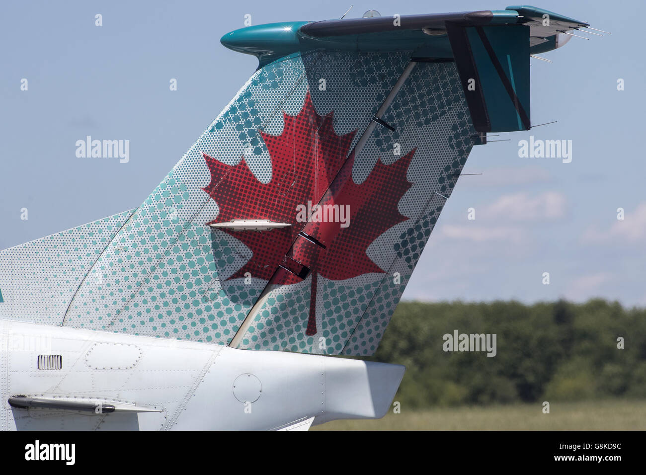 The tail on Air Canada Express Beechcraft 1900D aircraft, operated by Georgian before take-off at Norman Rogers - Stock Image
