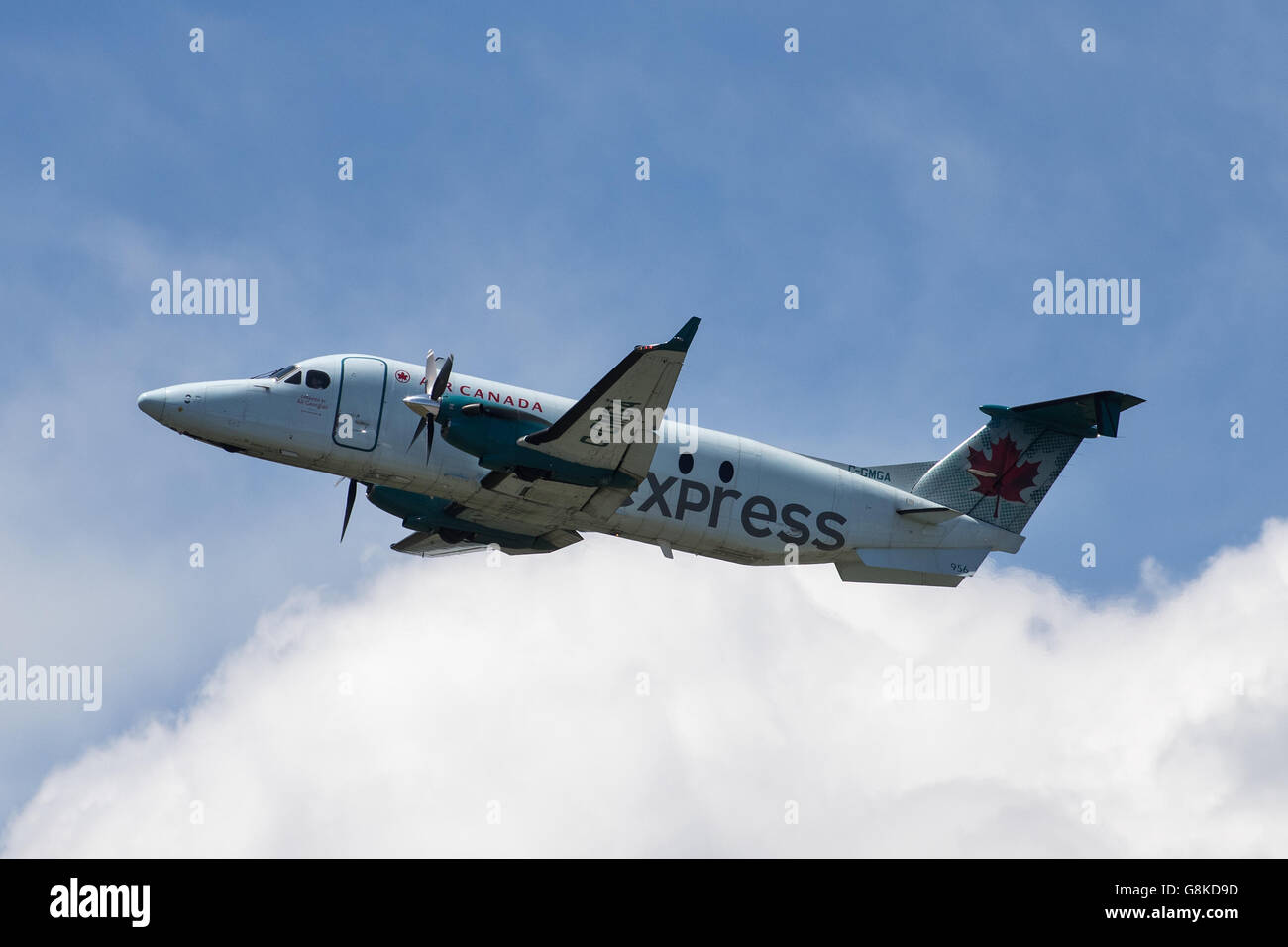 Air Canada Express Beechcraft 1900D aircraft, operated by Georgian air takes off from Norman Rogers airport in Kingston, - Stock Image