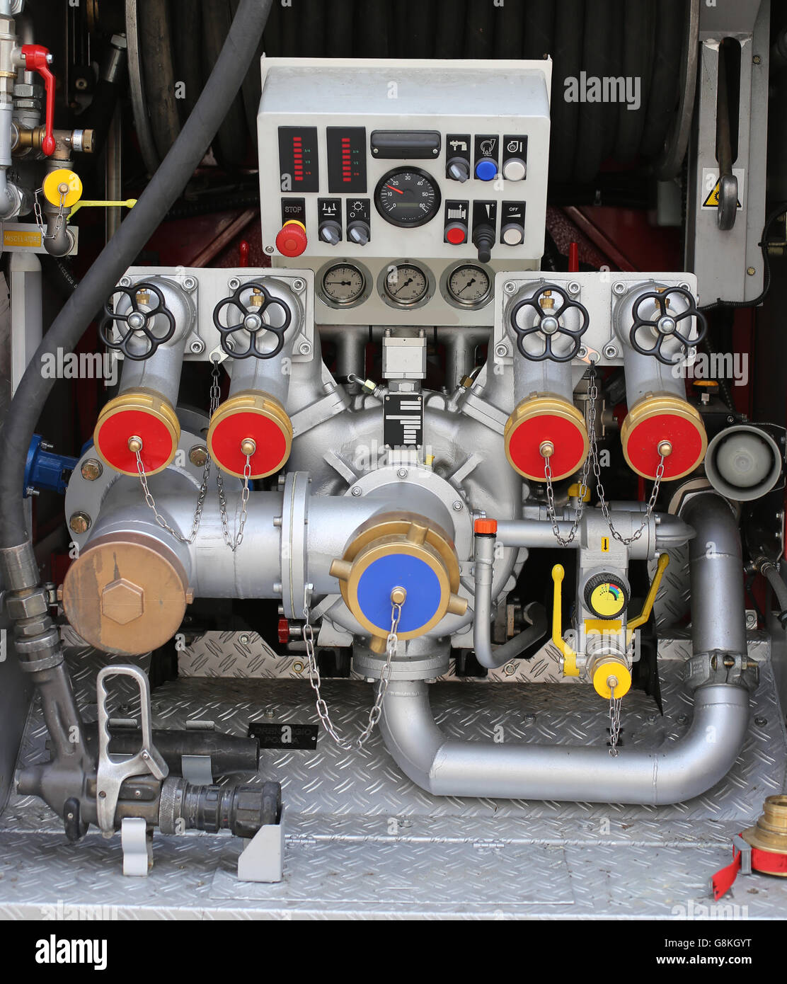 big automatic pump nozzles in fire truck with gauges and controls Stock Photo
