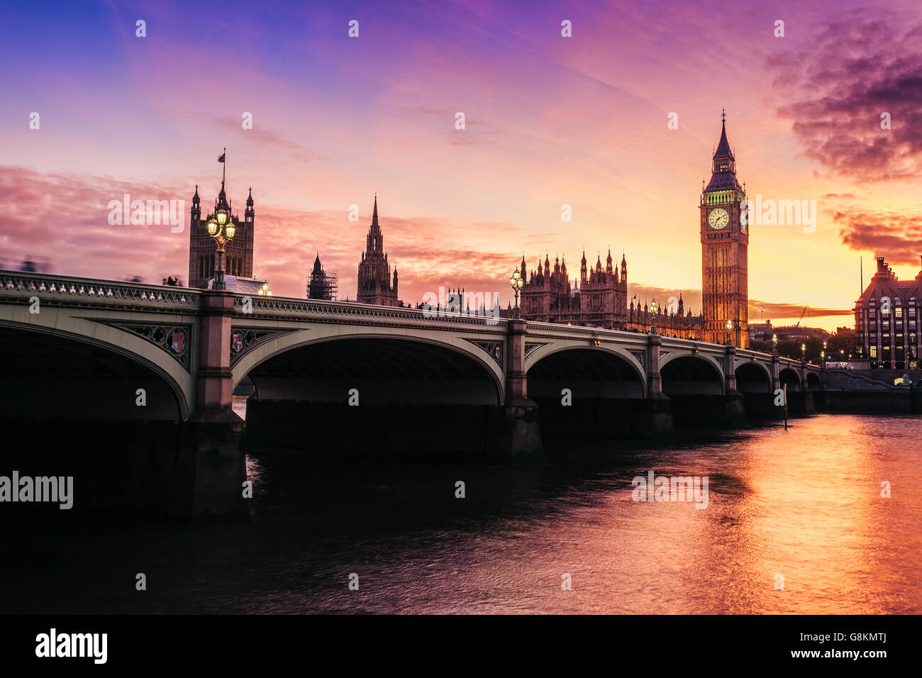 Dramatic sunset over famous Big Ben clock tower in London, UK. - Stock Image
