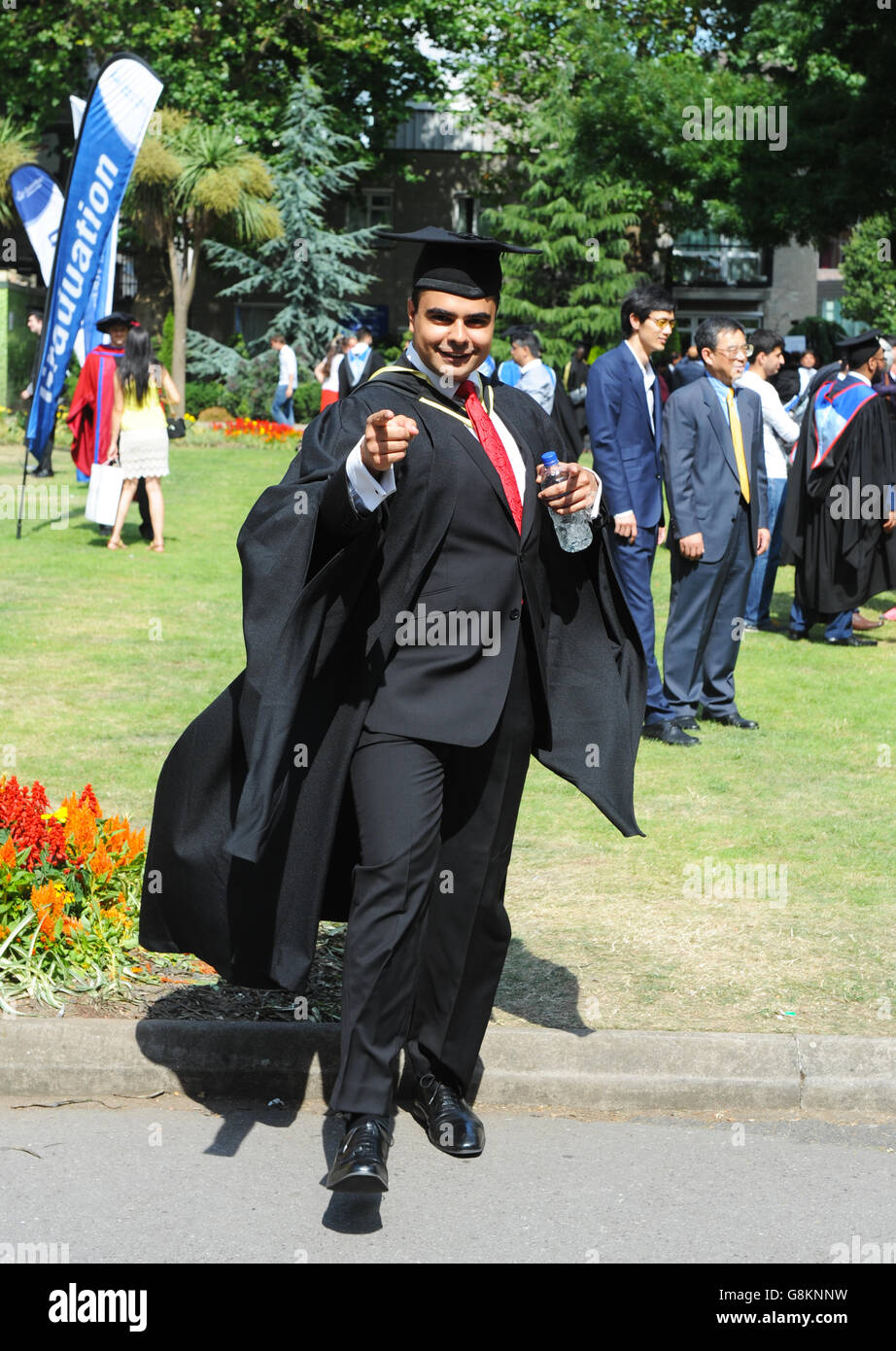 One male student graduate in full gown with hat expressing enormous joy on graduation day at Queen Mary London University. - Stock Image