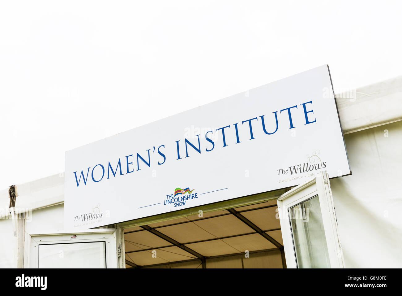 Women's institute WI sign womens organisation organization UK England GB community-based organisation for women - Stock Image
