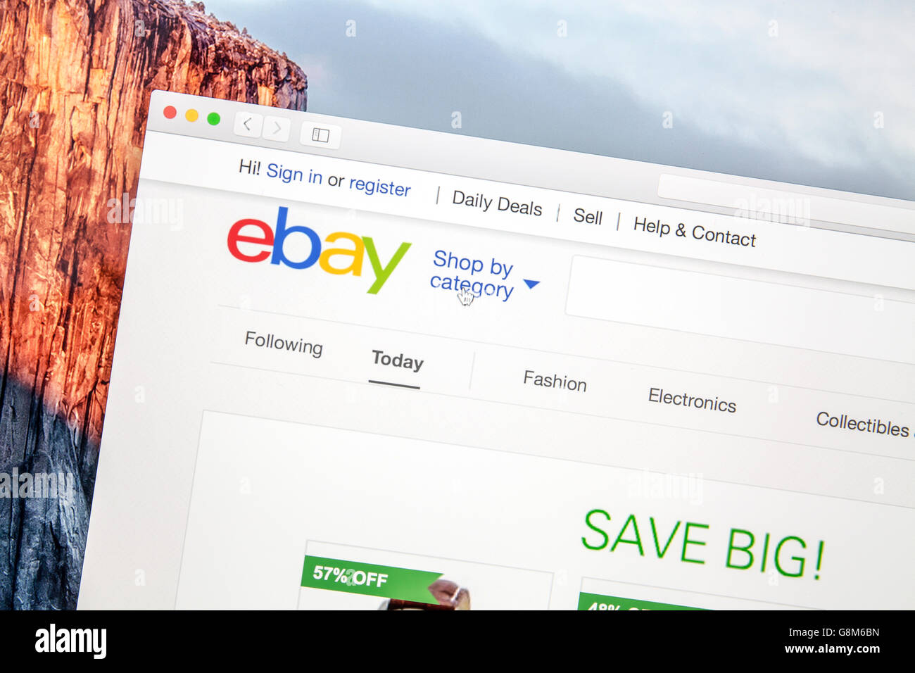 Ebay website under a magnifying glass  eBay is an american multinational corporation and e-commerce company - Stock Image