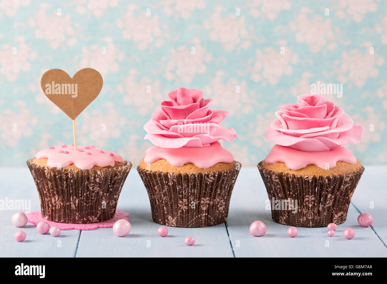 Cupcakes with heart cakepick for text - Stock Image