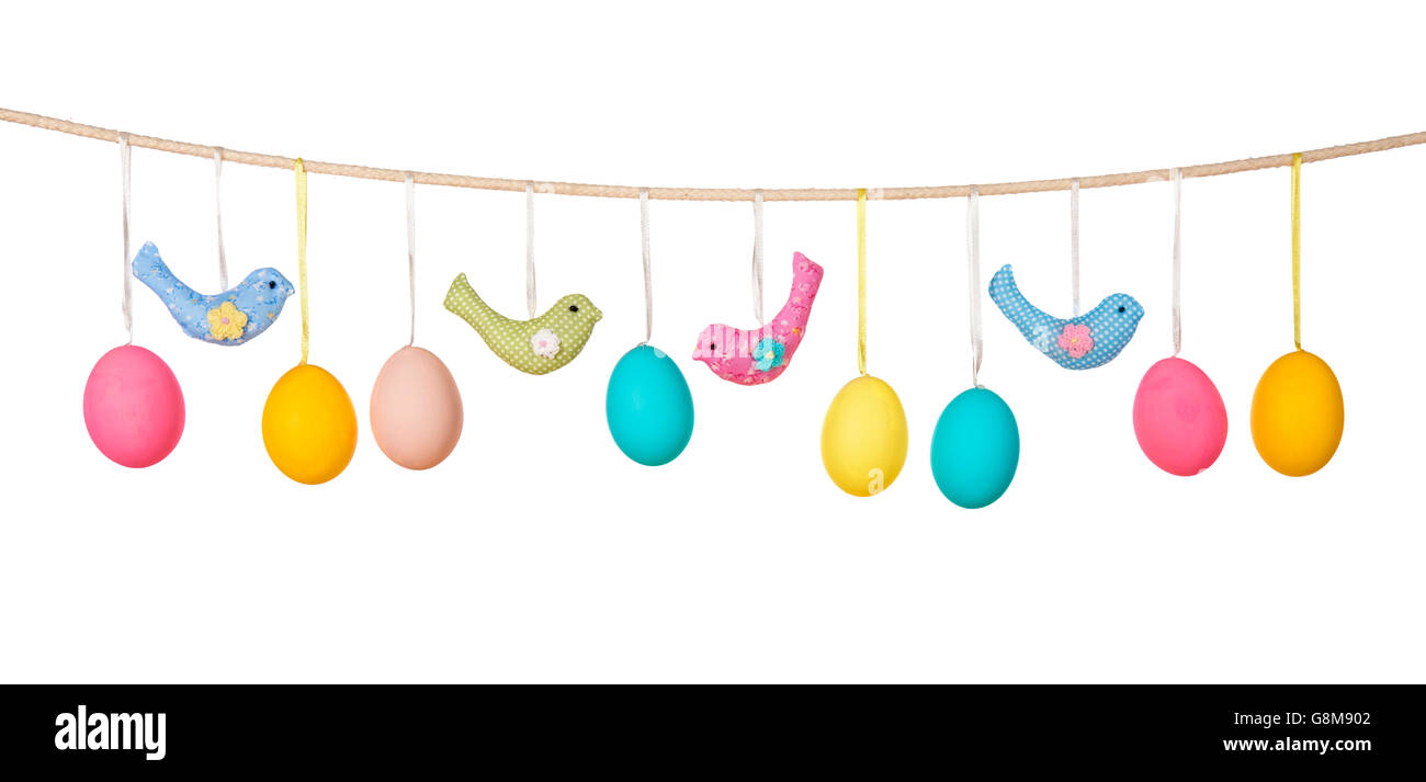 Easter eggs hanging on the clothesline isolated on white background - Stock Image