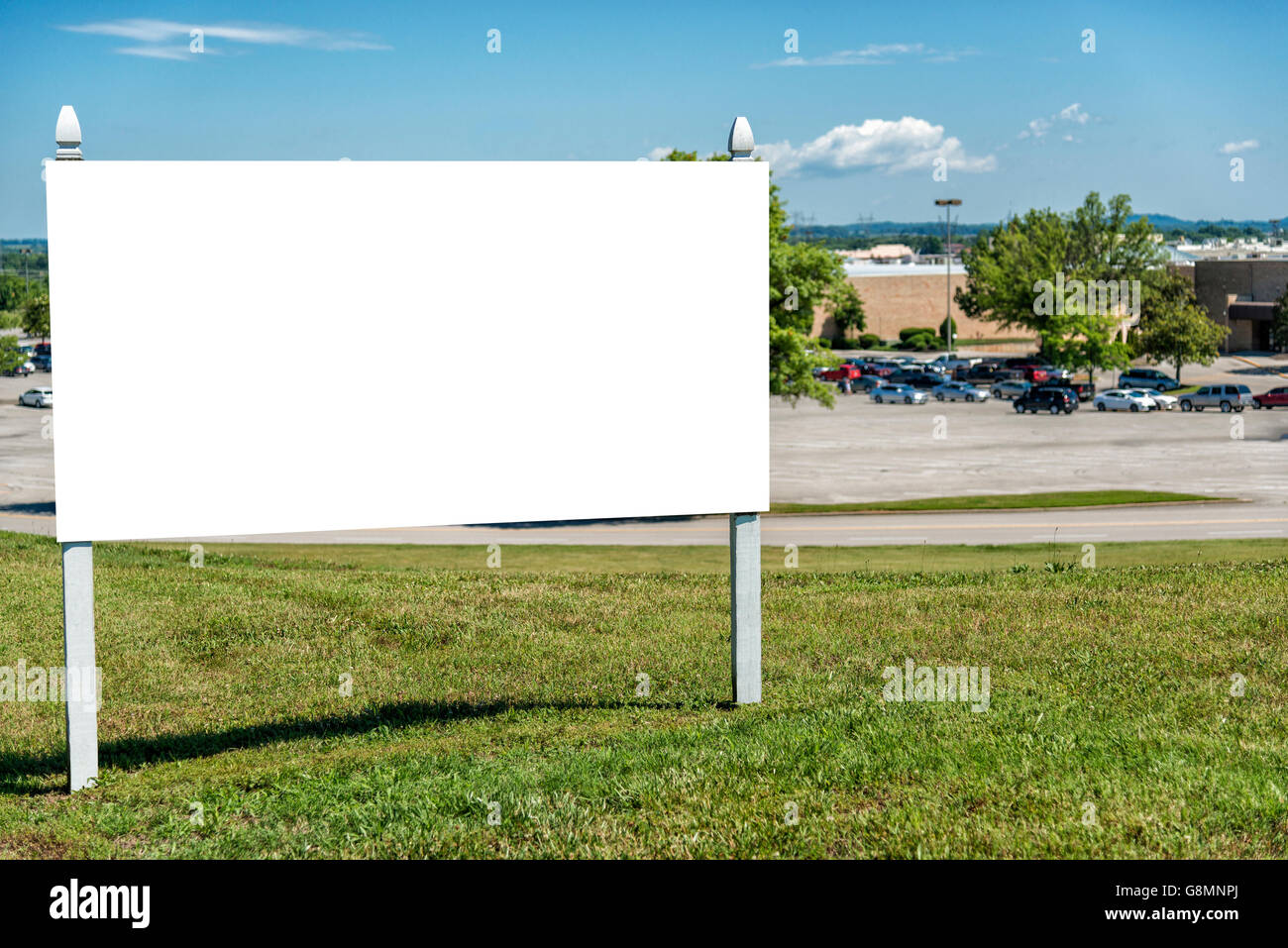Blank Real Estate Sign In Front Of Complex - Stock Image