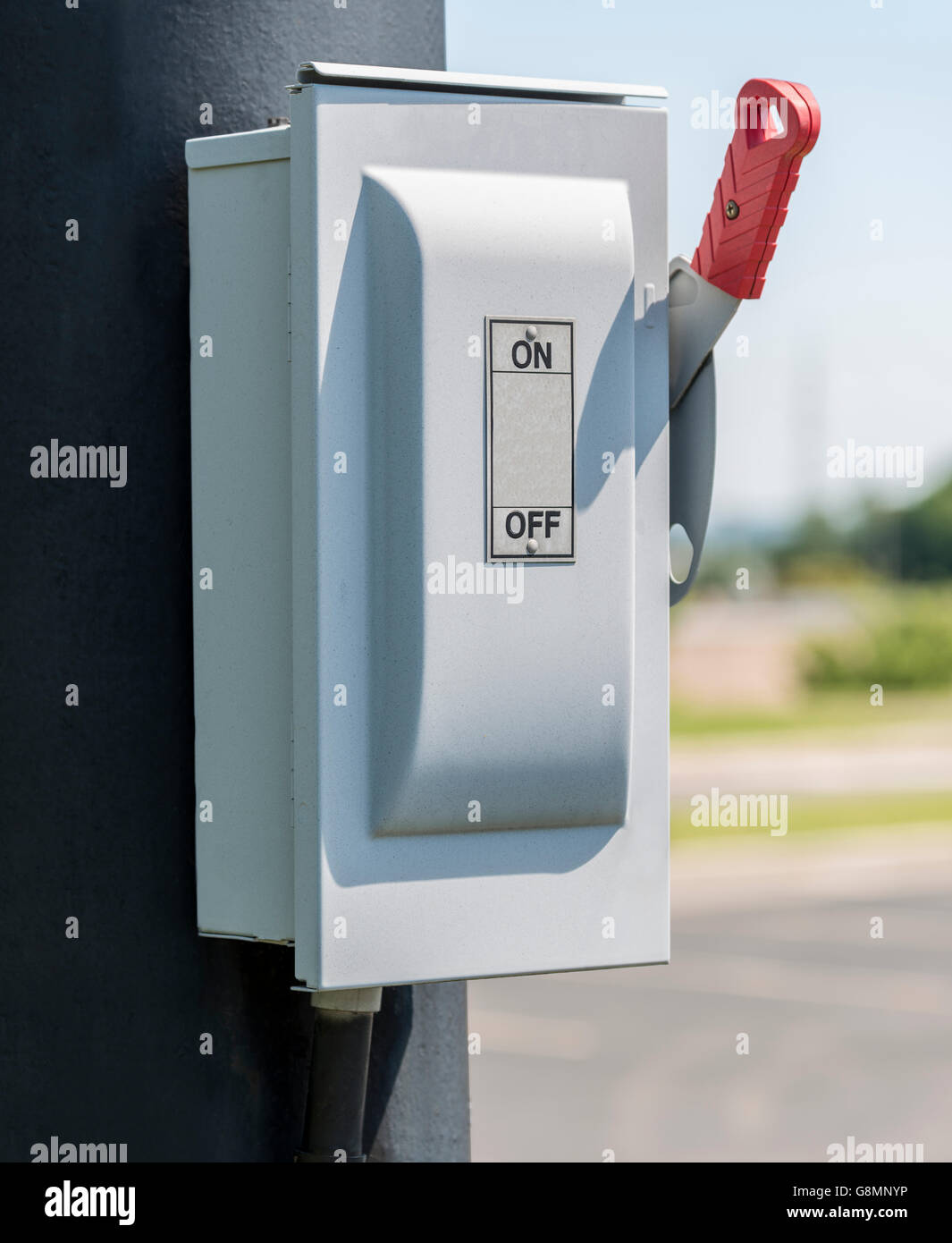 Vertical ON/OFF Lever on Electric box - Stock Image