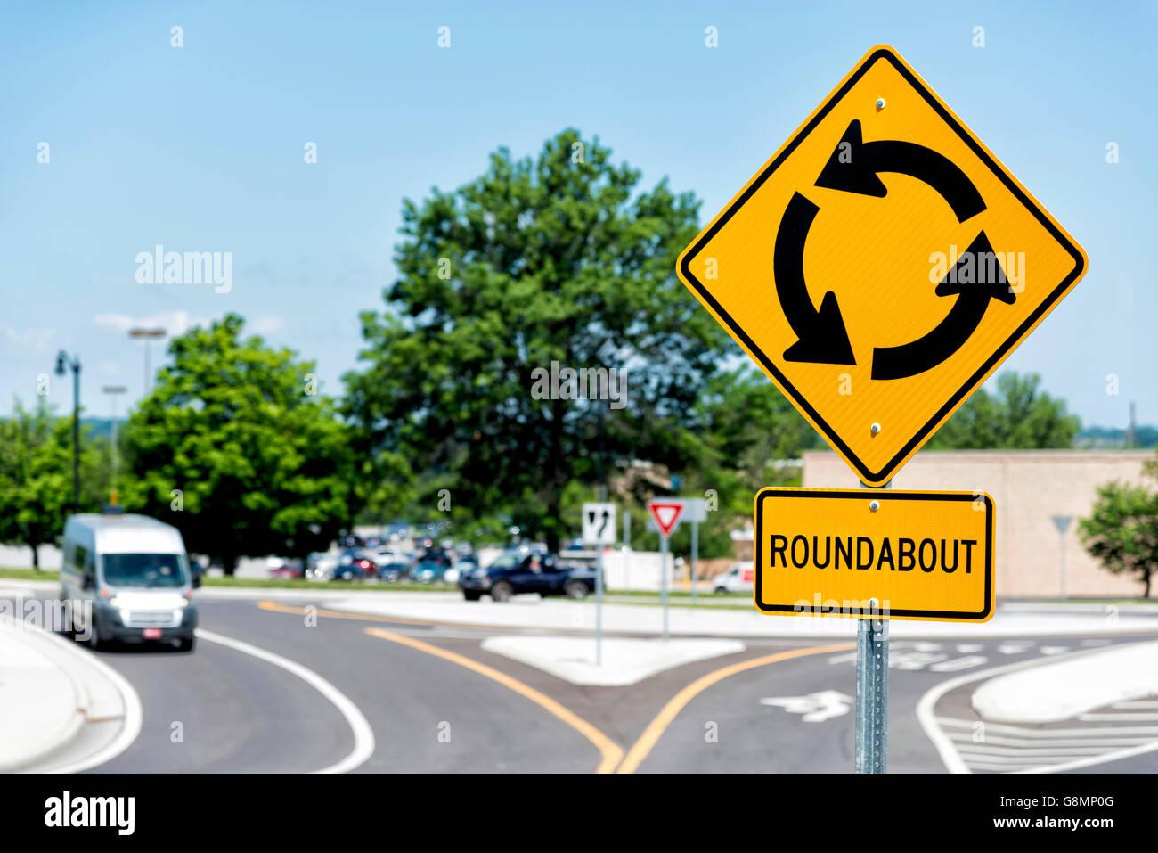 Roundabout sign  showing roundabout intersection. Horizontal shot. - Stock Image