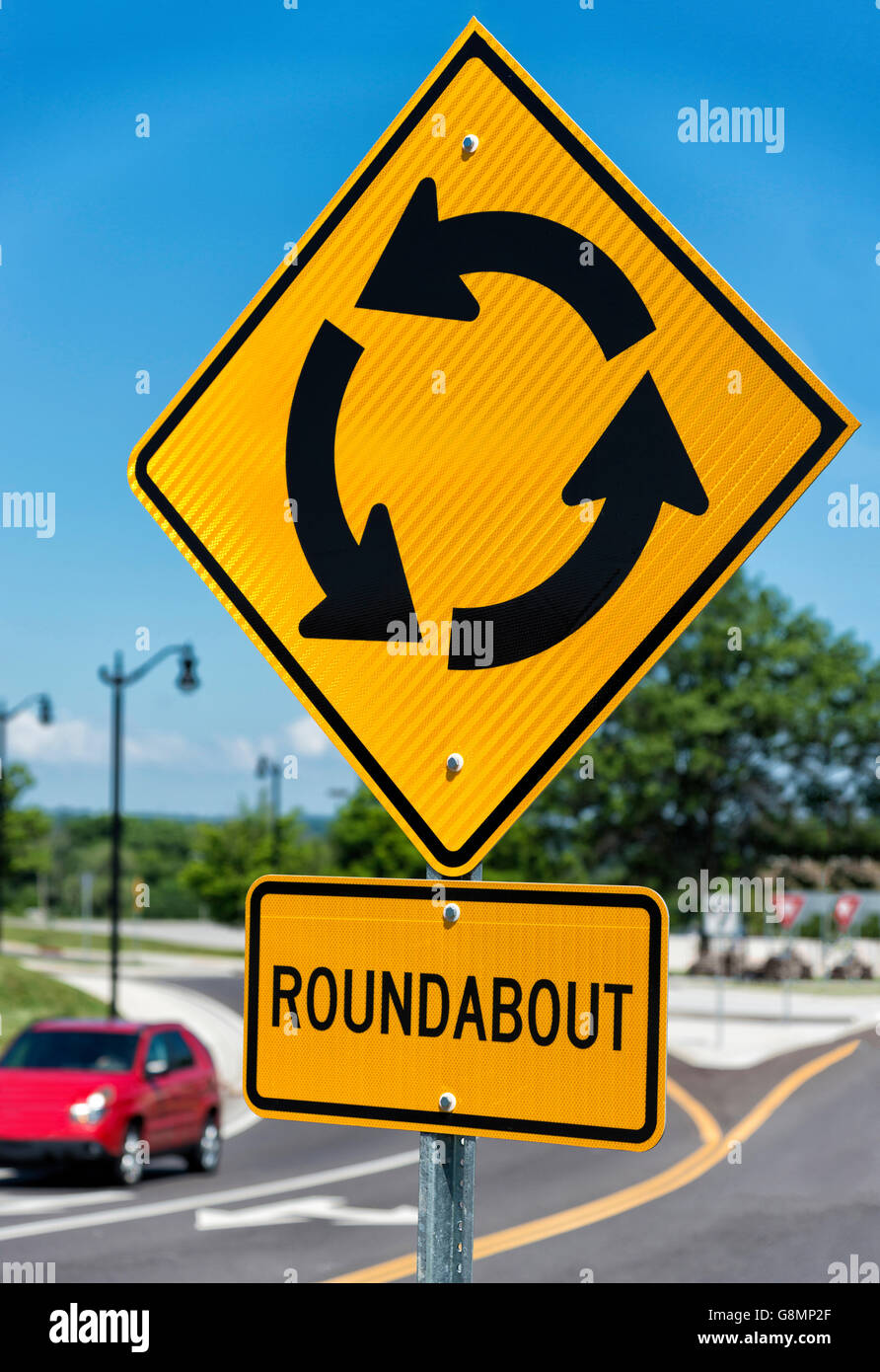 Sign For Roundabout Intersection vertical shot - Stock Image