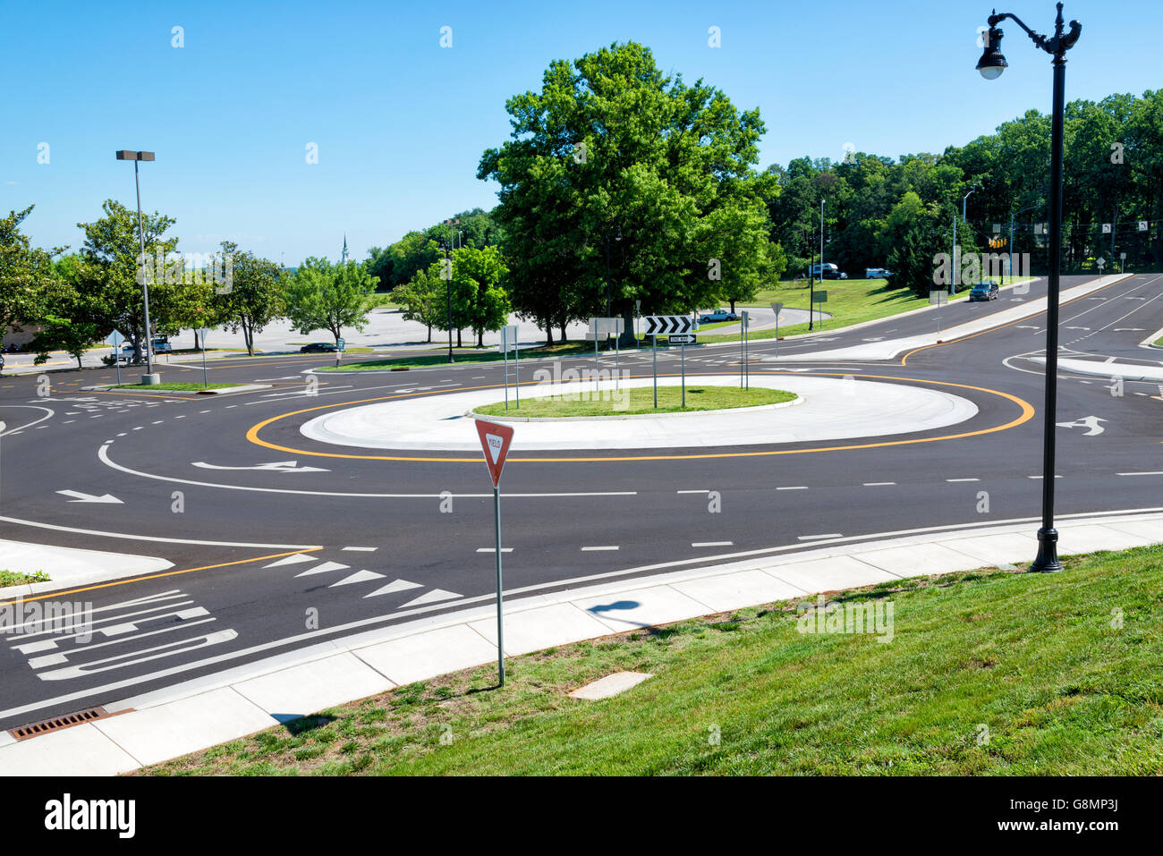 Traffic roundabout intersection in the suburbs. Horizontal shot - Stock Image