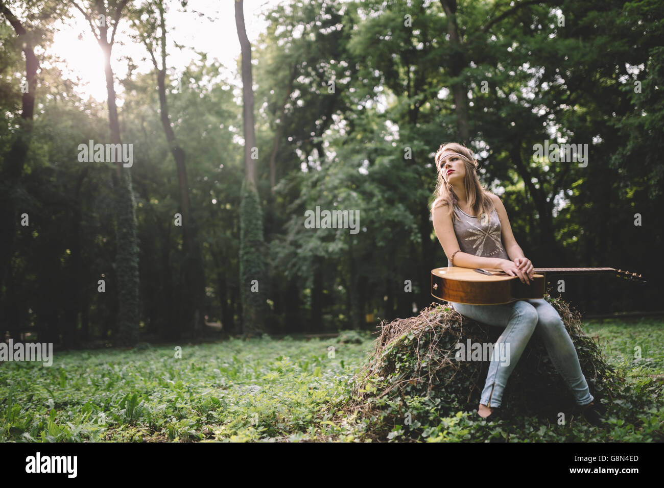 Depressed girl filling void after breakup in nature - Stock Image