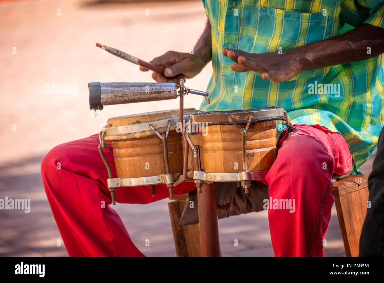 Street musician playing drums in Trinidad, Cuba - Stock Image