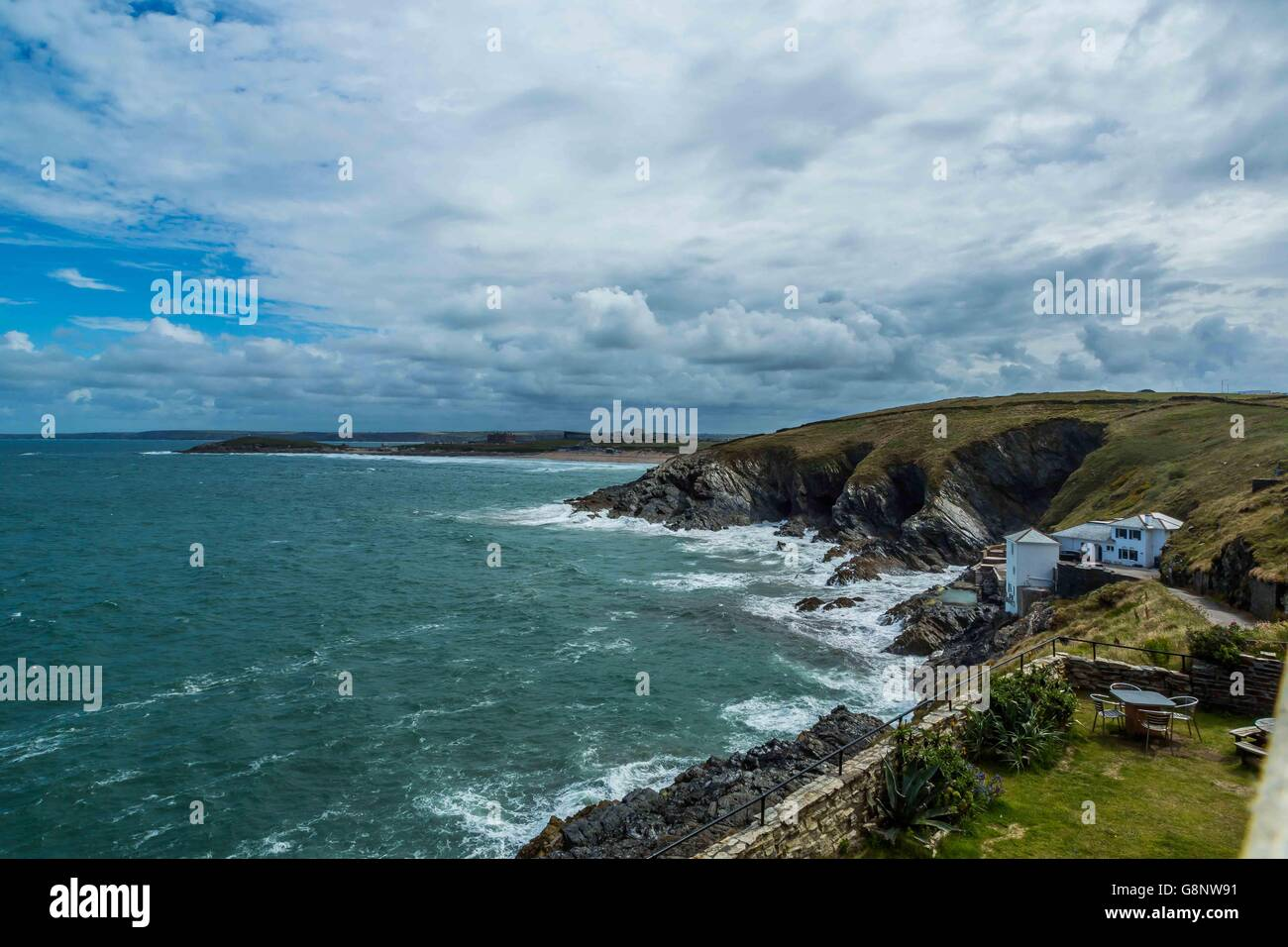 West Pentire waves and the blue sea ocean off the Cornish coast UK - Stock Image
