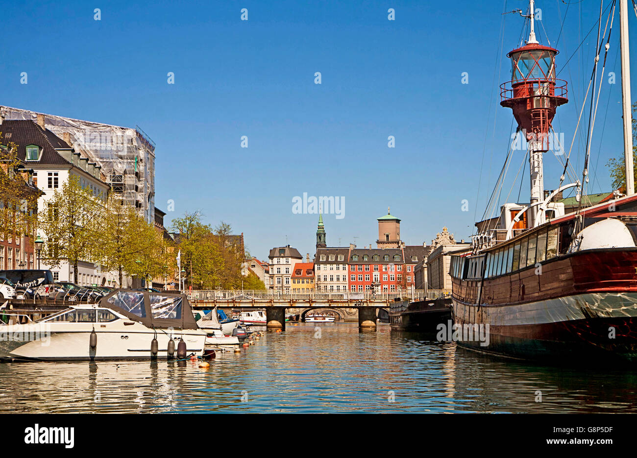 Copenhagen, Denmark - view of Frederiksholm Kanal with Lightvessel No. XI  house boat  and  bridges - Stock Image