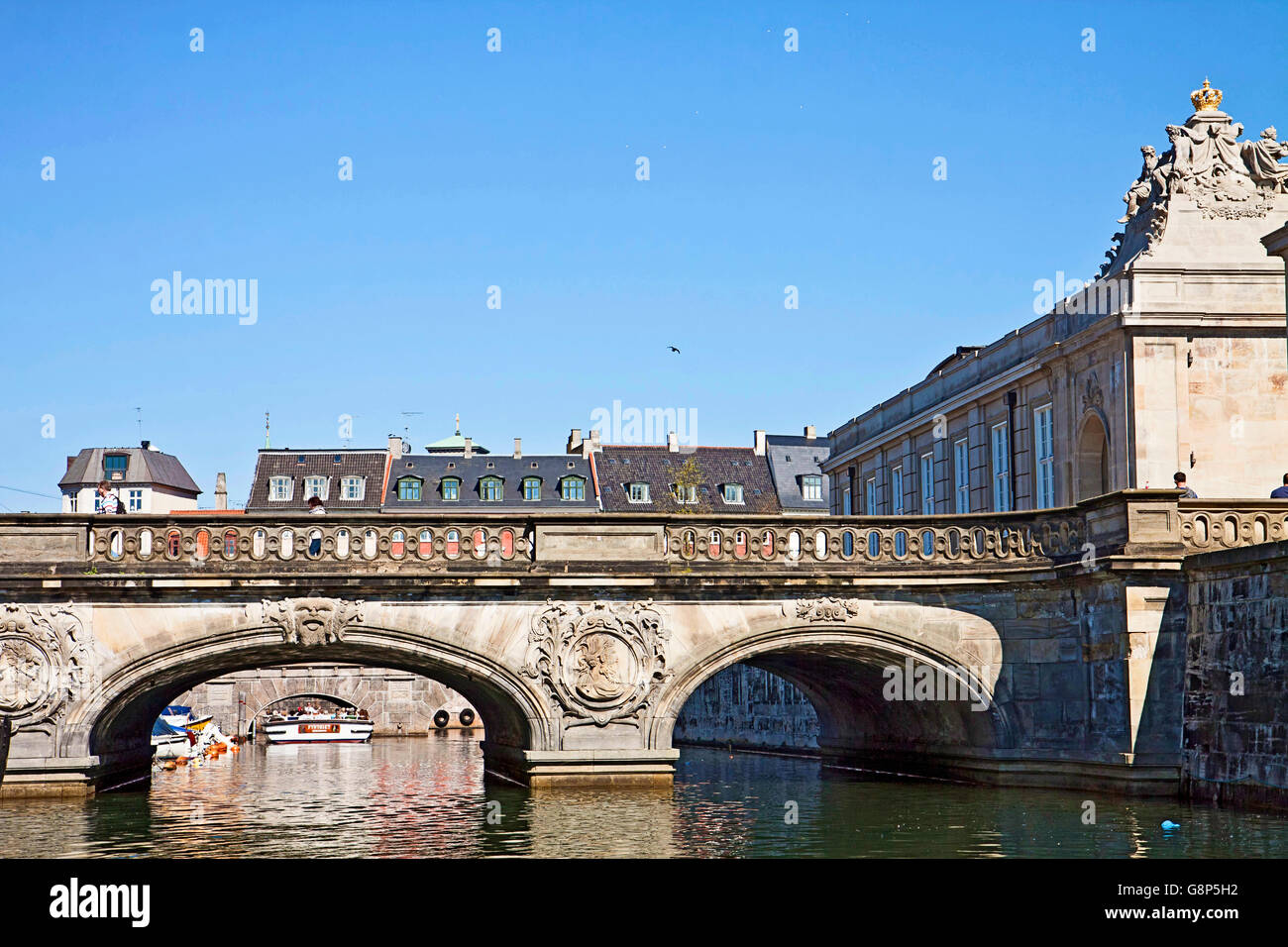 Copenhagen, Denmark - marble bridge to Christianborg Palace over Frederiksholm Canal in rococo style with the portal - Stock Image