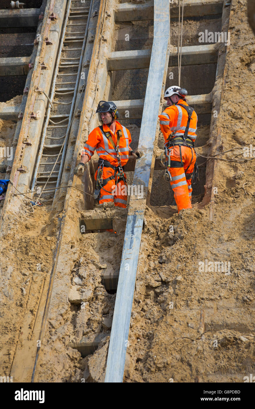 Abseilers clear fallen debris at East Cliff in June from the landslide that occurred in April at Bournemouth - Stock Image