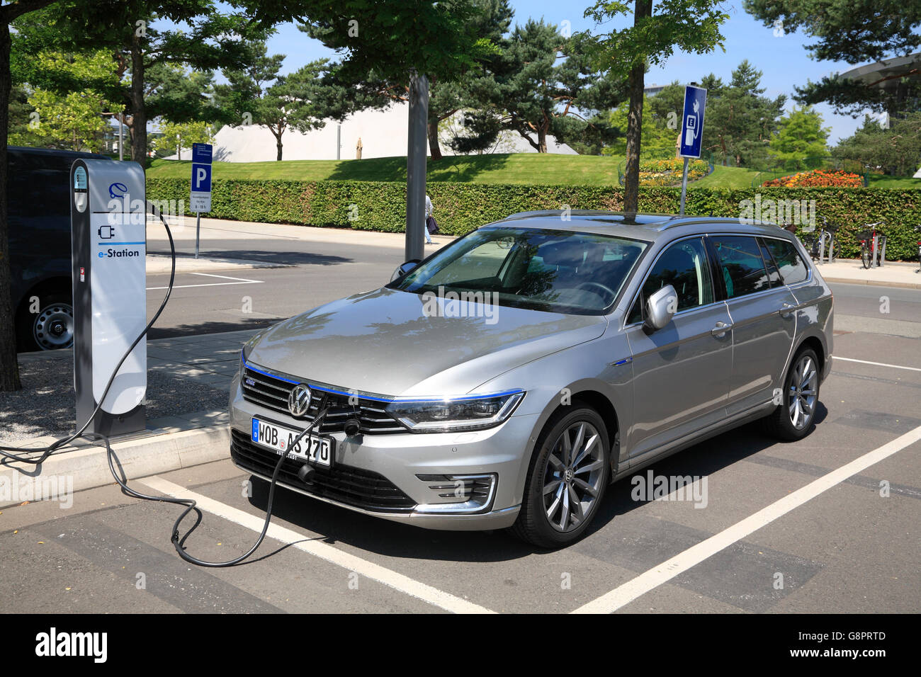 Wolfsburg, VW Autostadt , VW Passat e-car at charge station, Lower Saxony, Germany, Europe - Stock Image
