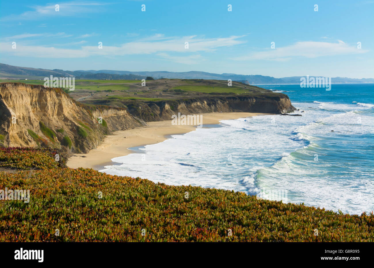 Half Moon Bay California shore ocean cliffs off of the Ritz Golf Course with waves sand at Half Moon Bay Golf Links - Stock Image