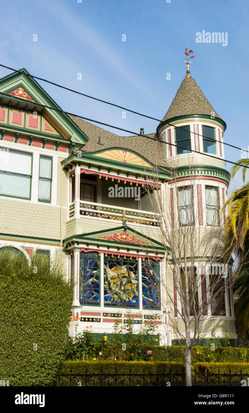 Petaluma California old Victorian home with stained glass and green colors - Stock Image