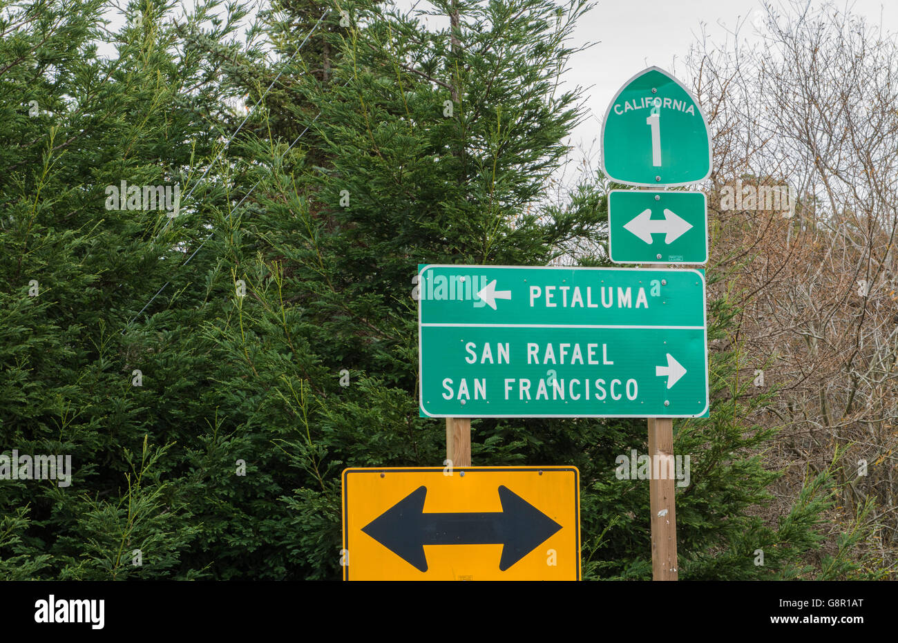 Point Reyes California road sign of Pacific Coast Highway Route 1 or PCH #1 with Petaloma and San Francisco and - Stock Image
