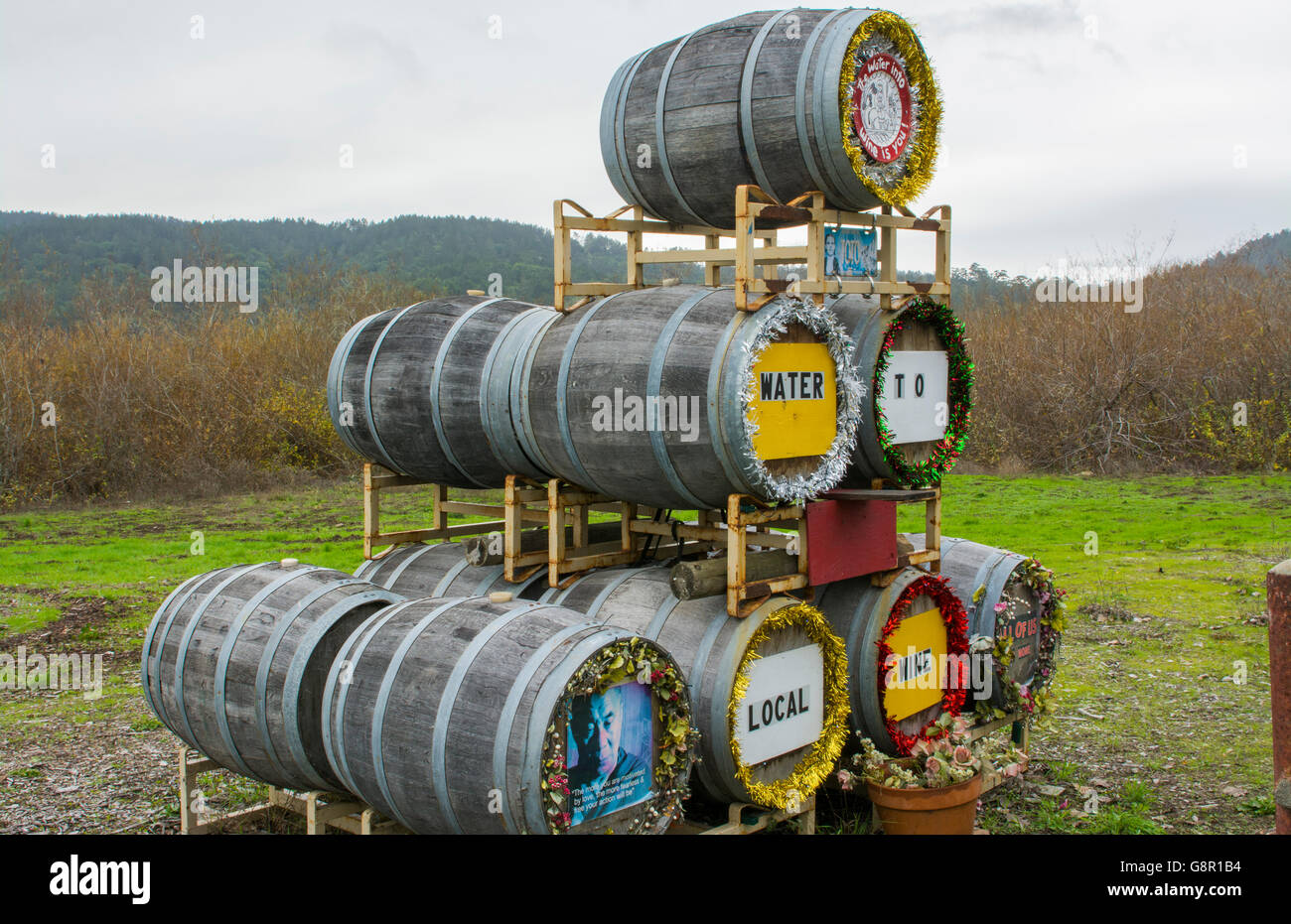 Point Reyes California Pacific Coast Highway Roiute 1 or PCH #1 wine barrels water to wine sign - Stock Image
