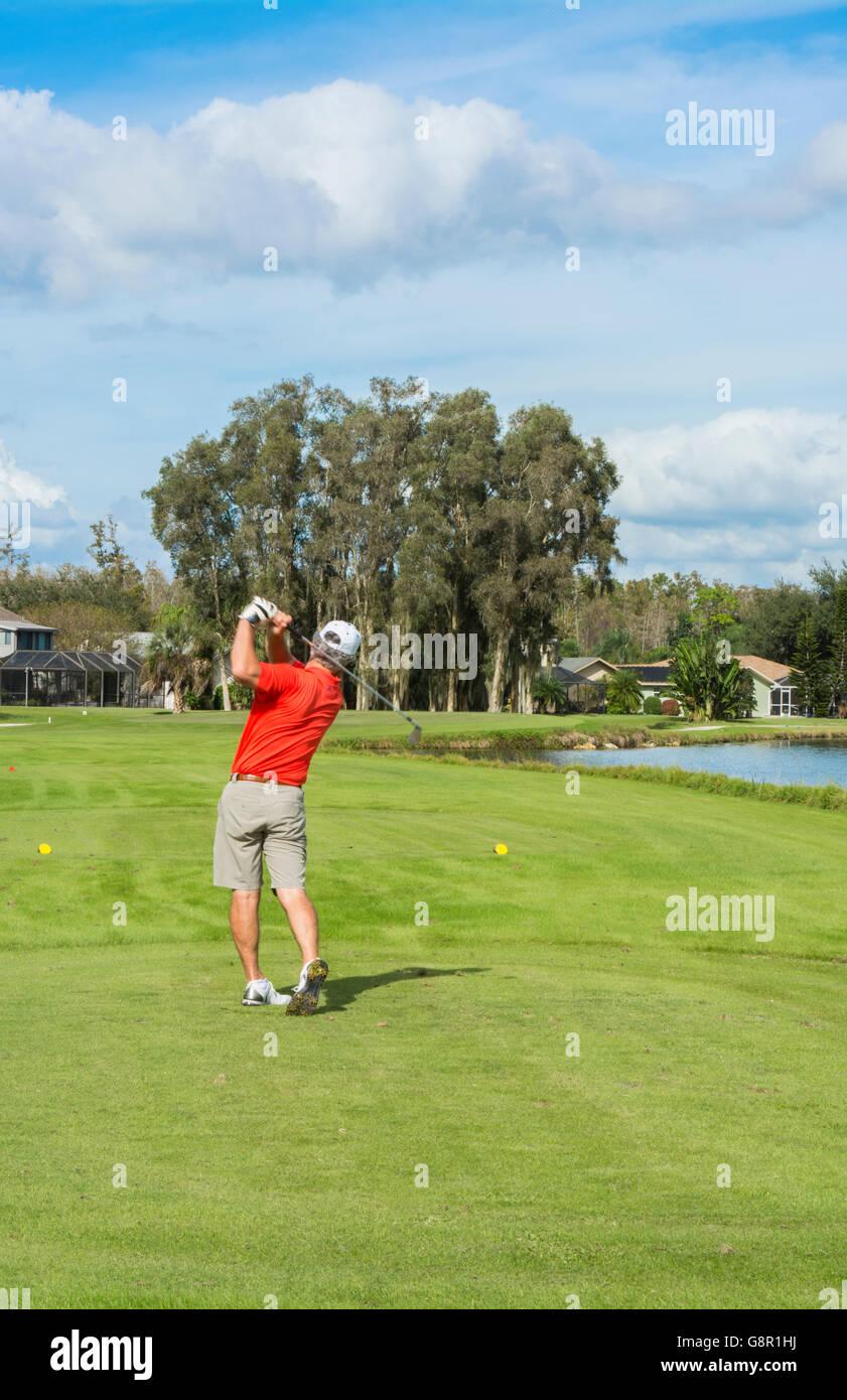 Ft Myers Florida golfer hitting ball on 5th hole of Eagle Ridge Golf Club driving on Par 3 hole - Stock Image