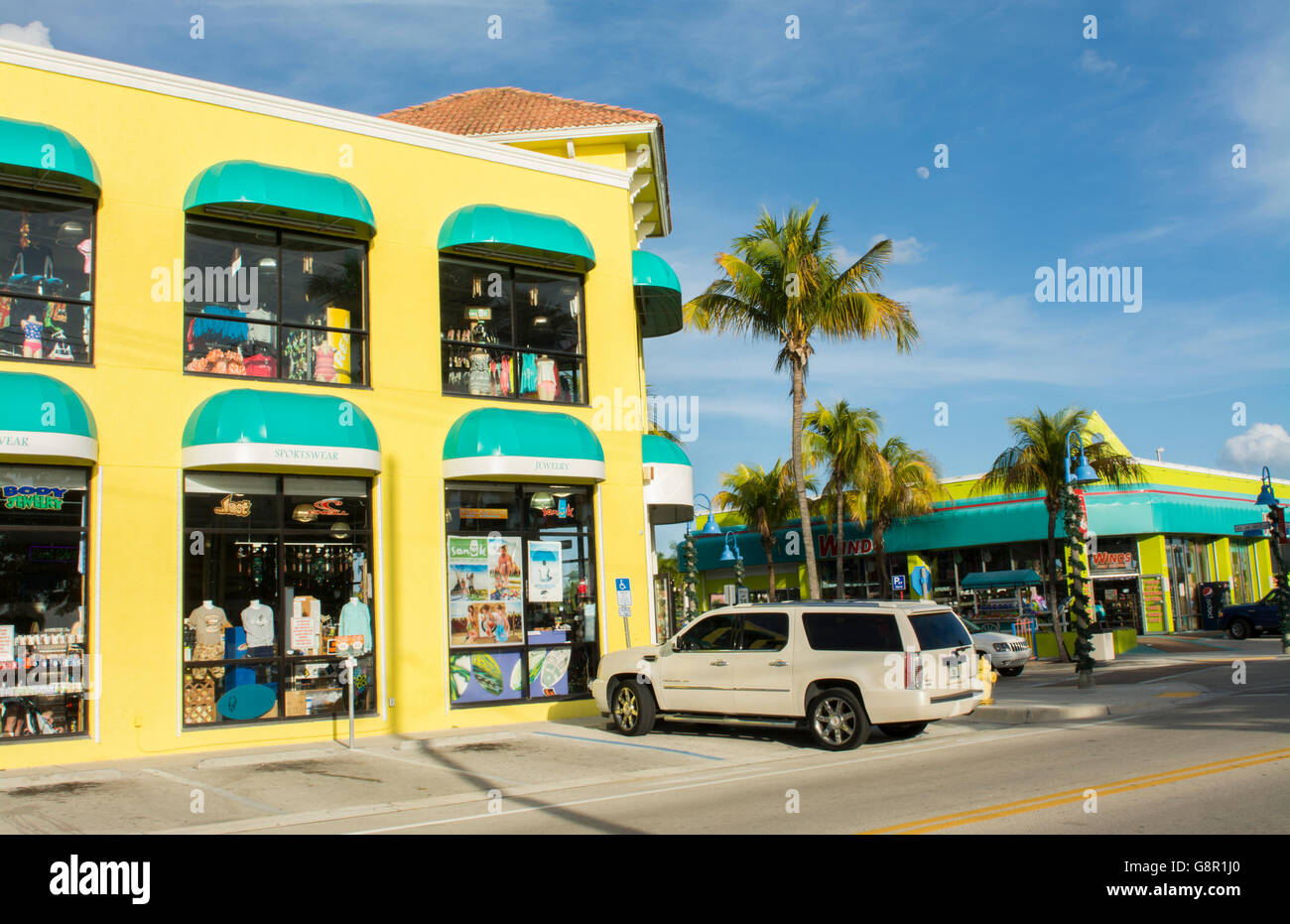 Ft Myers Beach Florida beach at famous pier with shops and colorful stores for Holiday tourists vacation - Stock Image