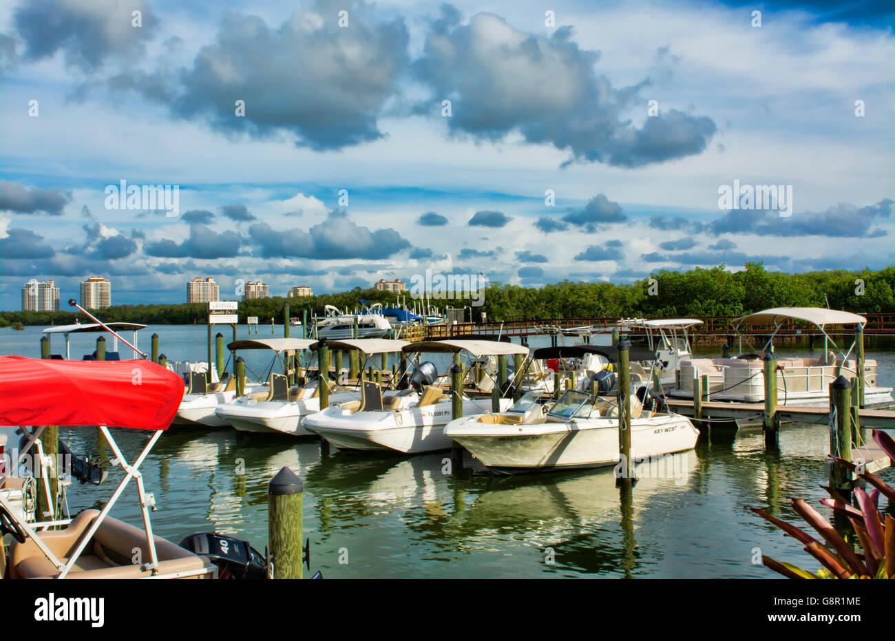 Bonita Springs Florida Big Hickory Marina with boats on intercoastal waters in bay relax restaurant - Stock Image