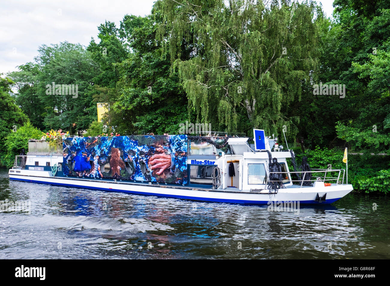 'Bue Star' Reederei Riedel river boat for river and canal trips with decorative artwork on exterior, River - Stock Image