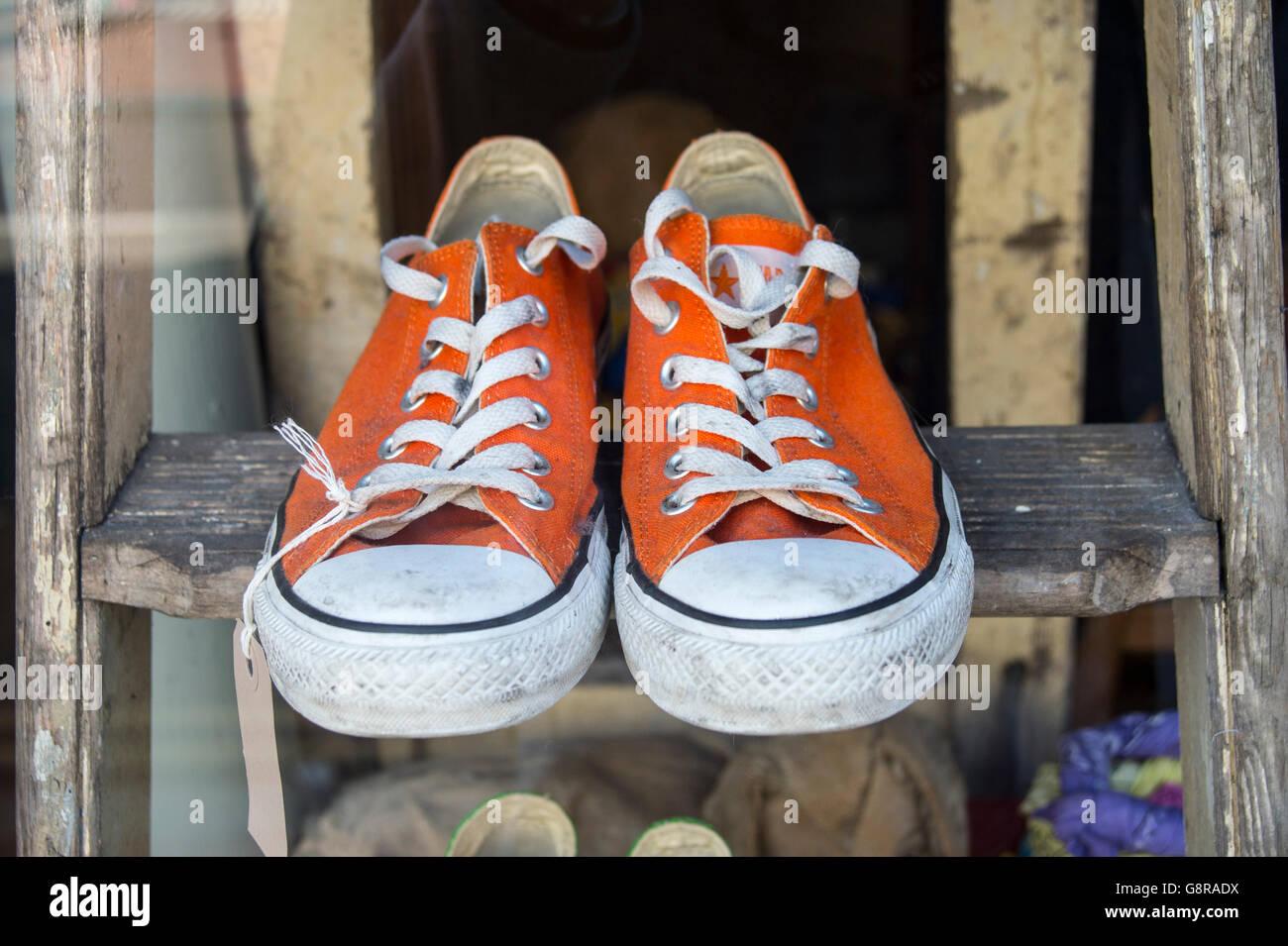 pair of orange converse trainers - Stock Image
