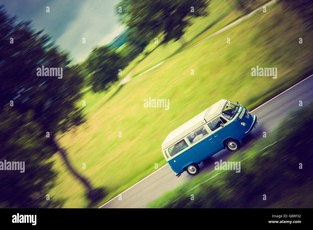 VW Bus Classic Car on the Road - Stock Image