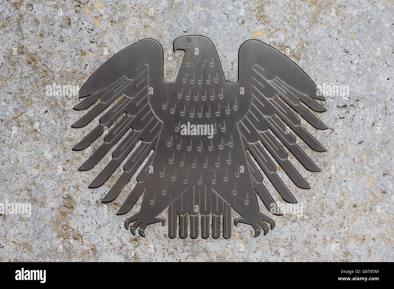 The german eagle (Bundesadler), the logo of the German Bundestag at the Bundestag building. - Stock Image