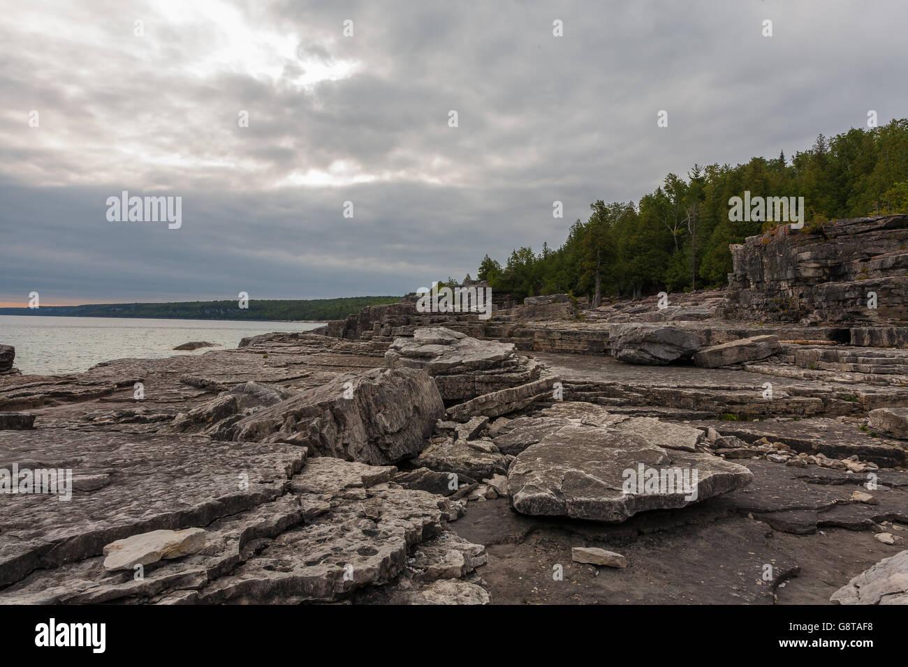 Rocky beach at Halfway Log Dump in Bruce Peninsula National Park near Tobermory, Ontario, Canada - Stock Image