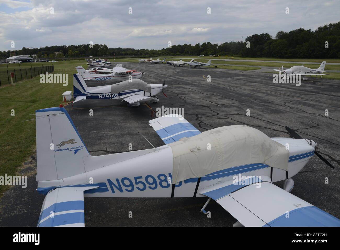 small airplanes parked on lot at the College Park airport - Stock Image