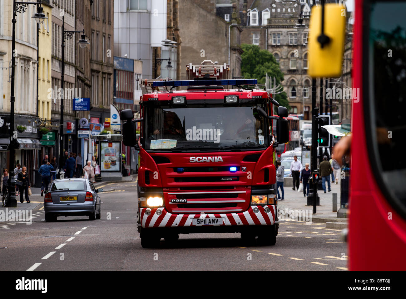 Scottish Fire And Rescue Service Fire Engine responding to a 999 Emergency call along the Overgate in central Dundee, - Stock Image