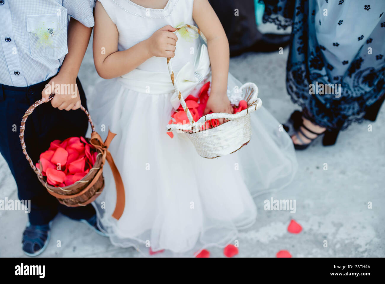 Cute little boy and girl in a white dress and suit with basket Stock ...