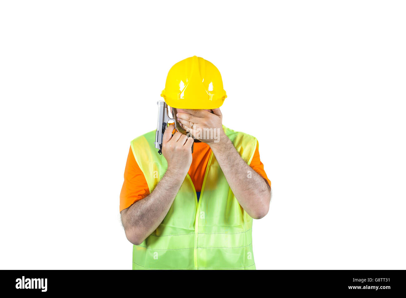 failure sadness guilty Manuel worker regretful gun in hand isolated on white portrait. - Stock Image