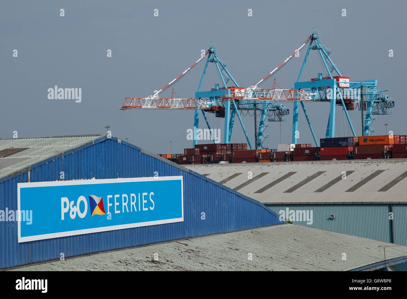 Two ship-to-shore gantry cranes behind the P&O ferry terminal ate at Liverpool Freeport dock, Bootle Liverpool, - Stock Image
