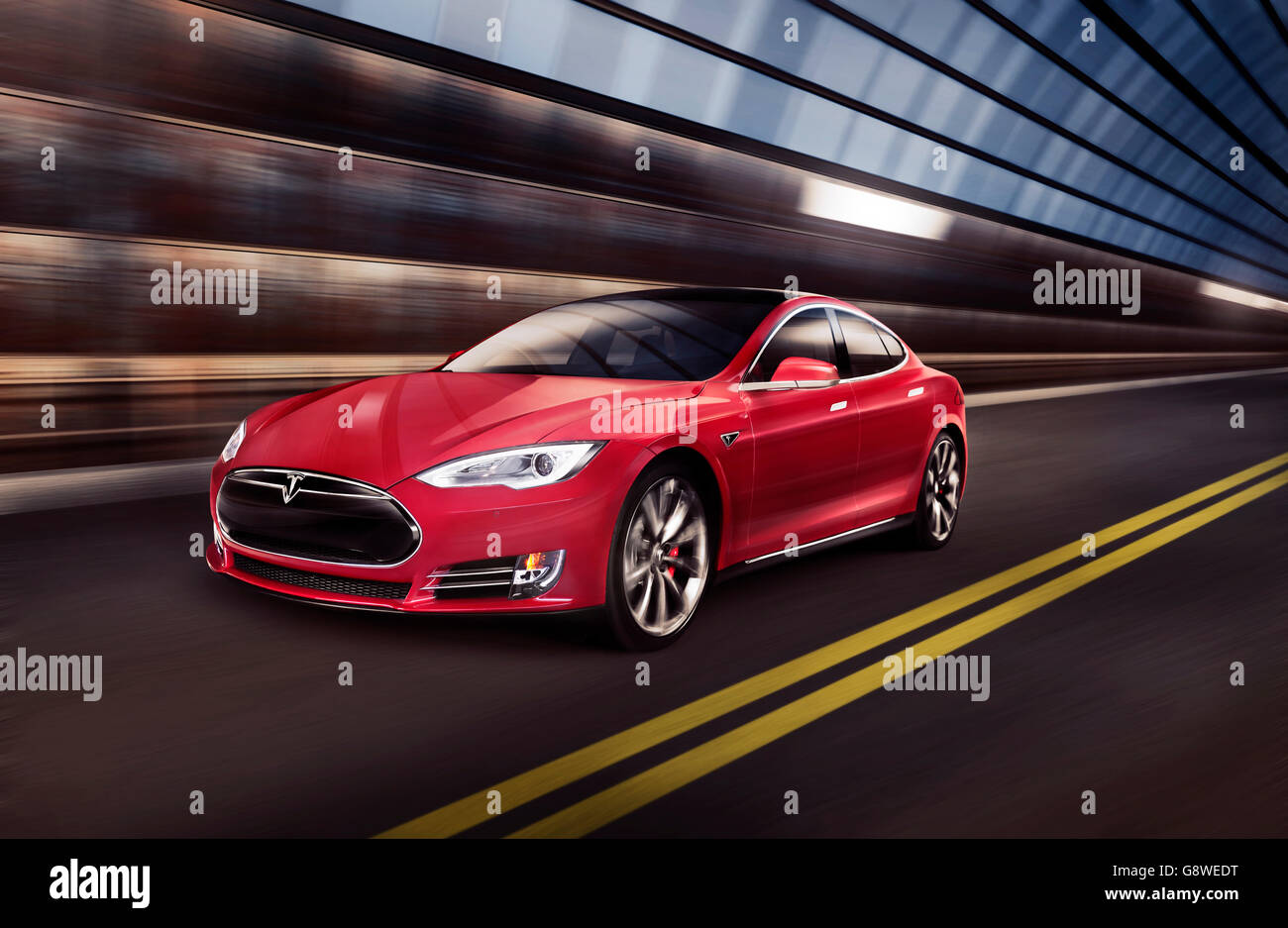 Red Tesla Model S luxury electric car speeding along a metal industrial tunnel - Stock Image