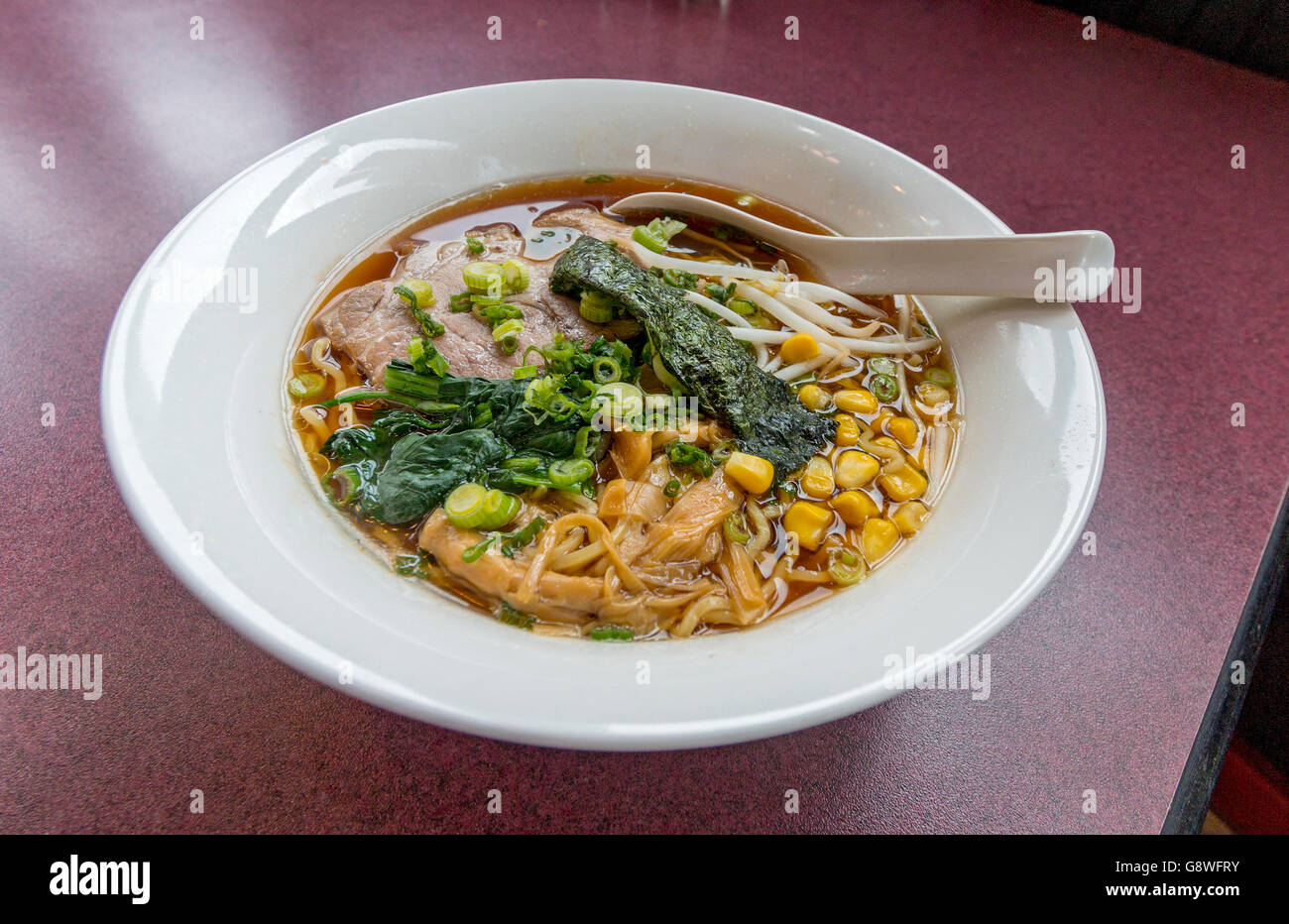 Ramen (also called larmen), here with noodles, meat, corn, vegetables in a broth that takes 6 hours to make. - Stock Image