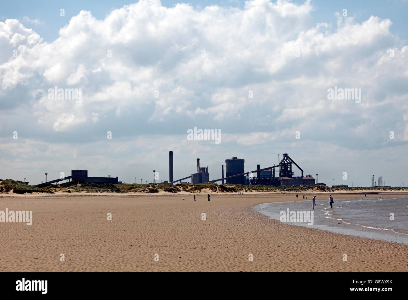 Redcar beach with the steelworks behind. - Stock Image