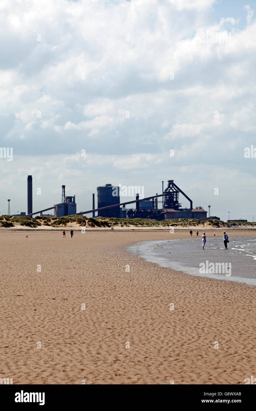 Wide  beach at Coatham Redcar and Cleveland, UK, in front of the Redcar steel works recently owned by Tata Steel. - Stock Image