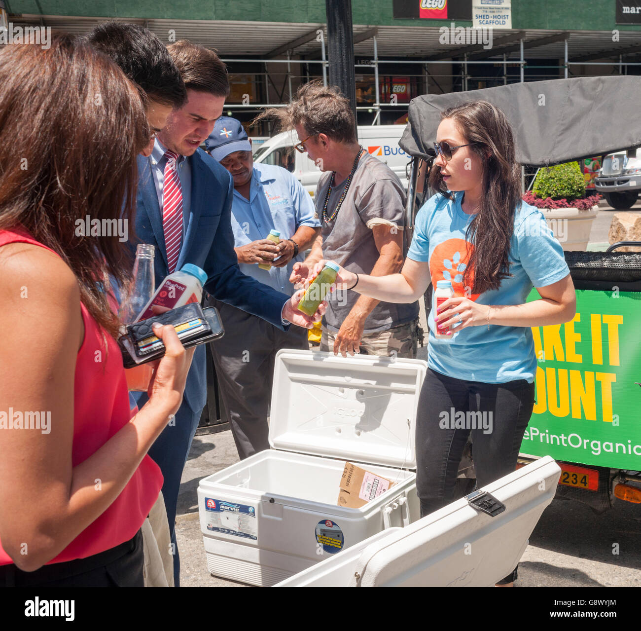 Workers give out samples of blueprint brand organic cleanse in stock workers give out samples of blueprint brand organic cleanse in flatiron plaza in new york on wednesday june 22 2016 blueprint manufactures organic juices malvernweather Choice Image
