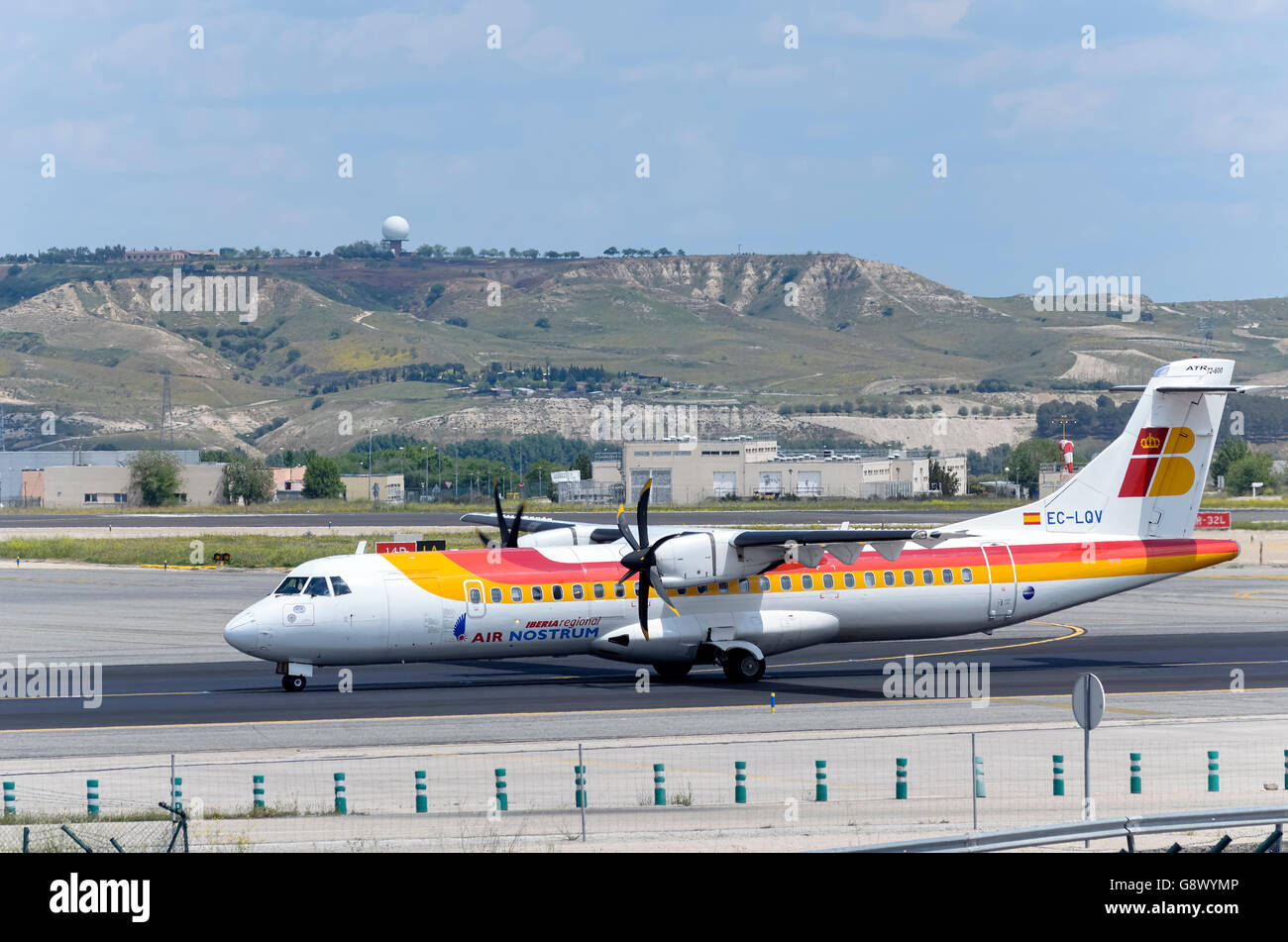 Aircraft -ATR 72 - 600- of -Air Nostrum- airline, direction to runway of Madrid-Barajas airport, ready to take off - Stock Image