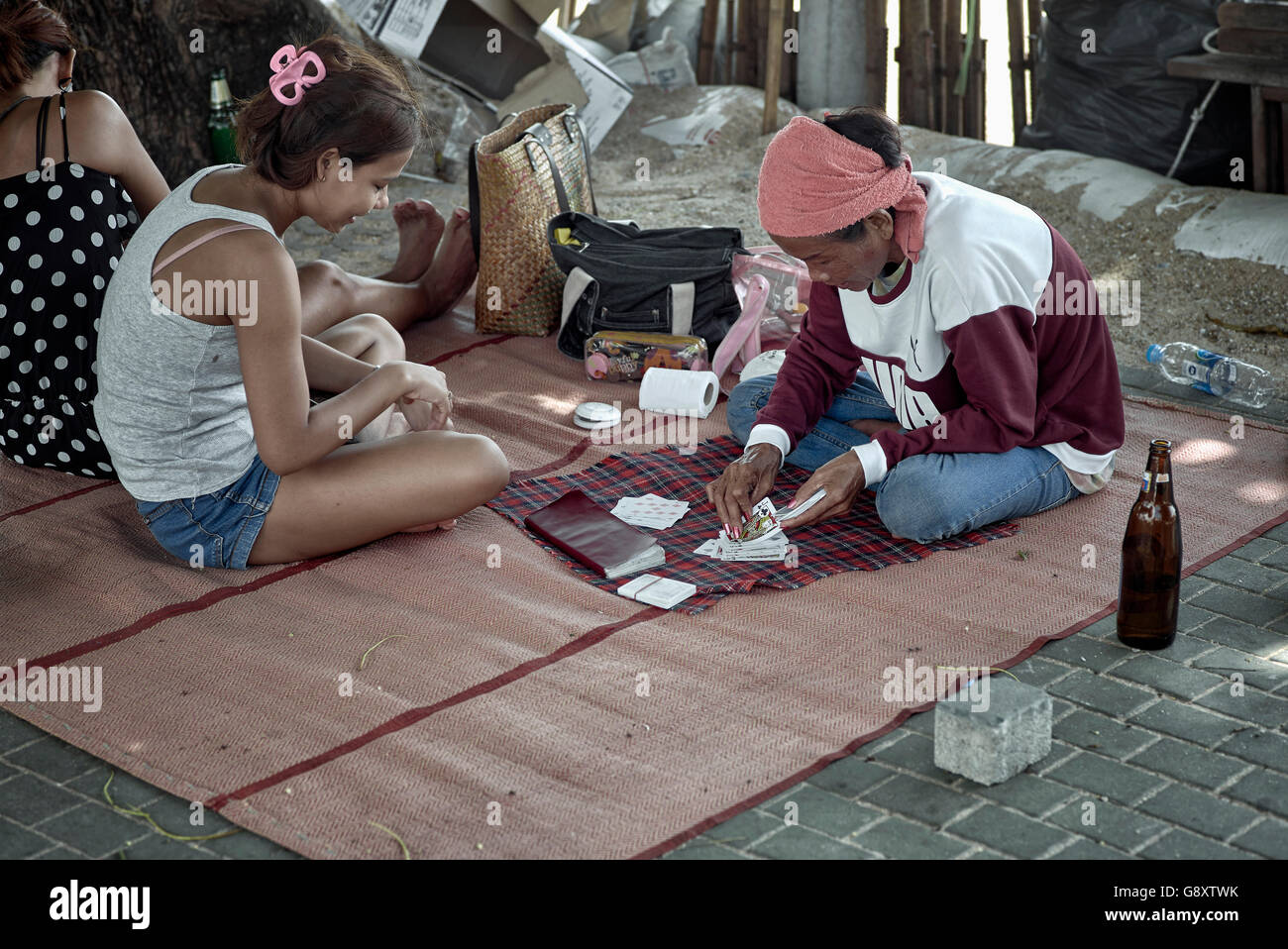 Thailand street fortune teller reading cards with customer. Pattaya Thailand S. E. Asia - Stock Image