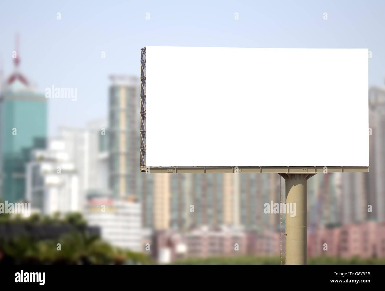 blank white billboard outdoor in big city - Stock Image