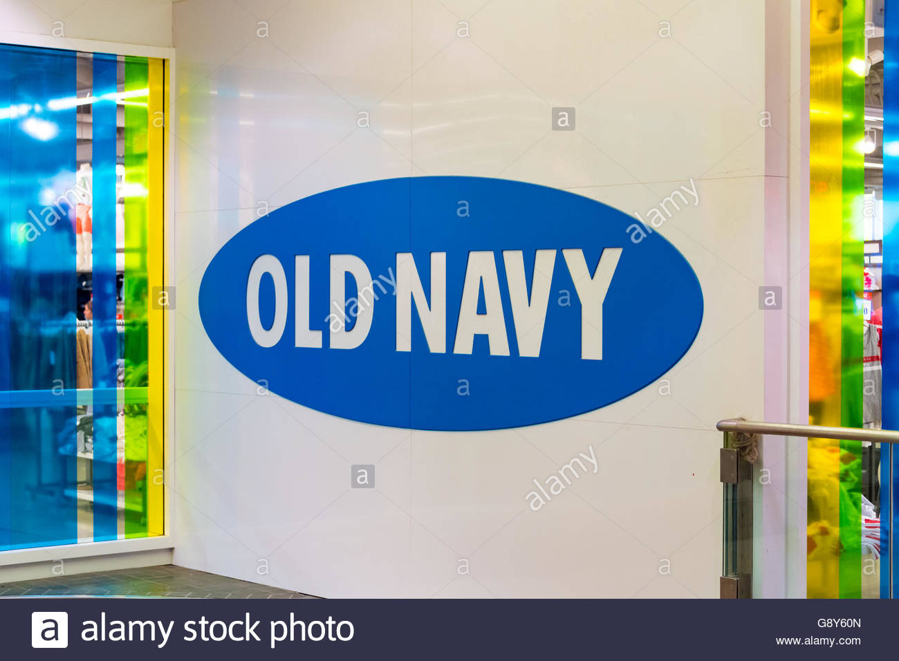 Old Navy blue logo printed on wall. Old Navy is an American clothing and accessories retailer owned by American - Stock Image